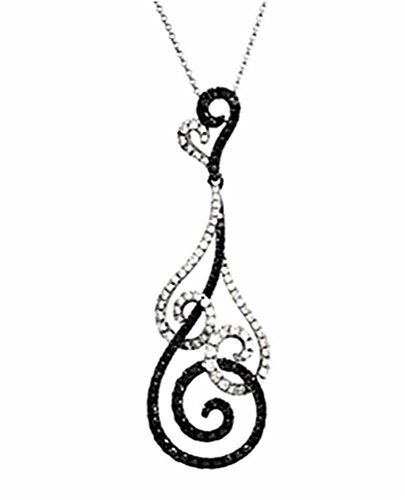 Gleaming Black and White Diamond Adorned Pendant is Crafted in Polished 14k White Gold   • Pendant Measures 49.00 Millimeters Tall x 15.50 Millimeters Wide and 8.5 Millimeters Thick or 1.93 Inches High by .61 Inches Wide and .33 Inches Thick   • Suspended from 14k White gold 1.00 Millimeter, 18.00 Inch Rolo Chain   • Conflict Free Diamonds in Compliance with Kimberly Code of Conduct   • The Gold Used to Craft this is Earth Friendly; Made with Refined Karats System Certified by Scientific Certification Systems; Proudly Made in the USA ; Matching Diamond Earrings Offered