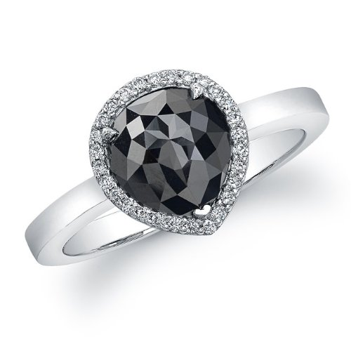 A single rose cut pear shaped black diamond weighting , sits surrounded by a halo of sparkling white diamonds in this unique 14k white gold ring. This fabulous look is the latest trend worn by many celebrities.
