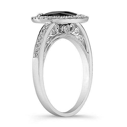This Coby Madison black diamond ring will add a polished touch with a 1.35 carat pear shape gleaming black diamond is set in white gold 40 round white diamonds weighing 0.25 carats.